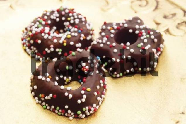 Chocolate-glazed fondant cookies with sprinkles