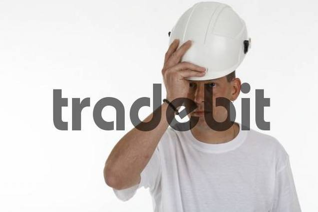 Man putting on a safety helmet, hardhat
