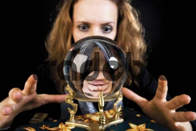 Fortune teller looking into a crystal ball