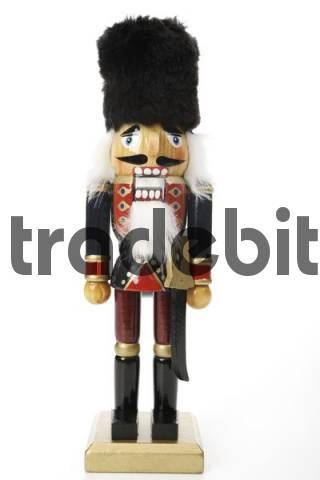 Nutcracker figurine with black felt hat