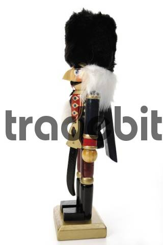 Nutcracker figurine with black felt hat, side-view