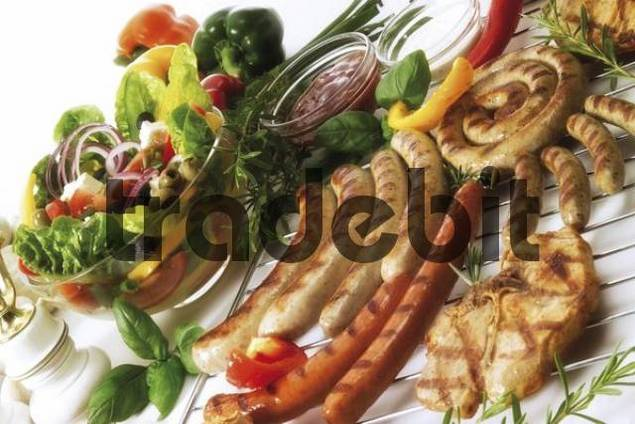 Barbecue: grilled meats including Polish sausages, Nuremburg bratwurst sausages, cutlets, assorted dips and a mixed salad