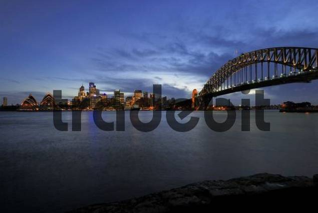 Sydney skyline with Sydney Opera House and Harbour Bridge at dusk, Sydney, New South Wales, Australia