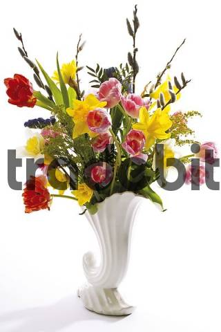 Spring flowers in a vase - tulips, pussy willows and daffodils