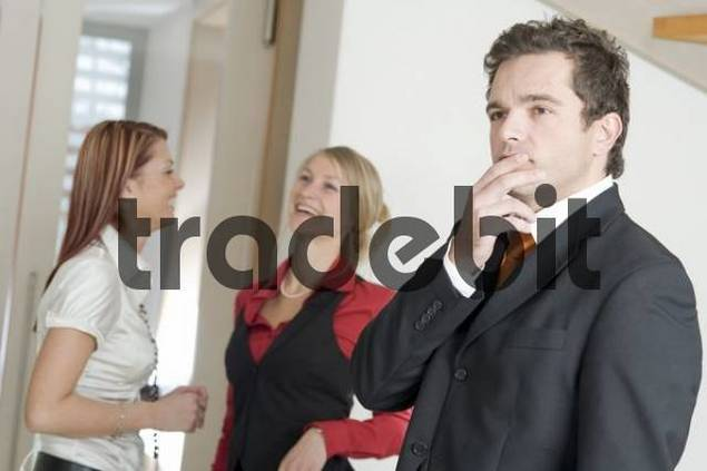 Three young businesspeople