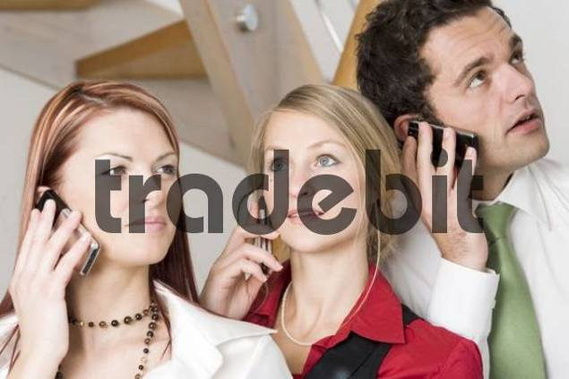 Young people talking on mobile phones, cellphones