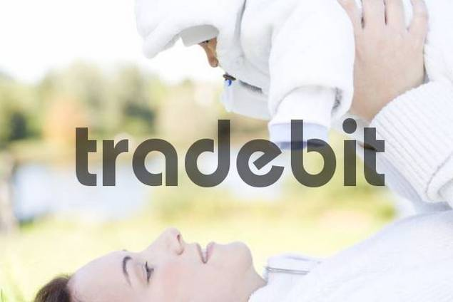 Young mother, 22 years, with daughter, six weeks old, outdoors