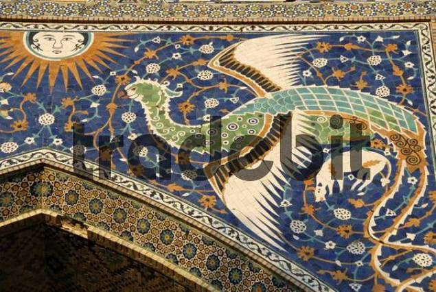 Artistic detail, majolica ceramics, peacock flying toward the sun, entrance to the Nadir Divan Begi Madrasah, Lebi Hauz, Buchara, Uzbekistan, Central Asia