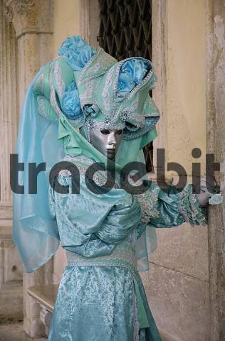 turquoise mask under arcades, carneval in Venice, Italy