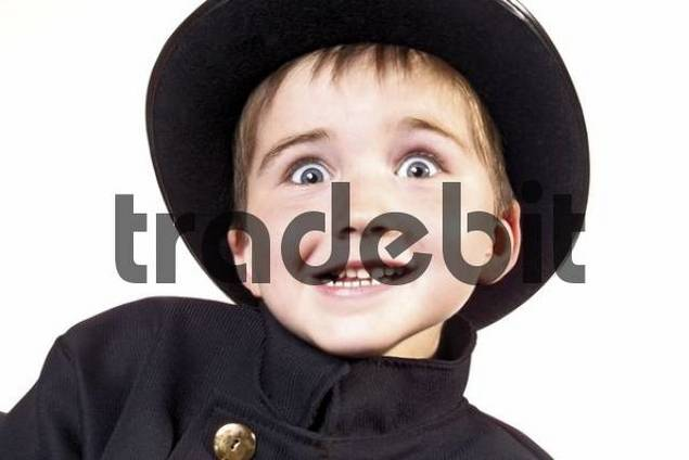 Cheeky playful boy dressed as a chimney sweep