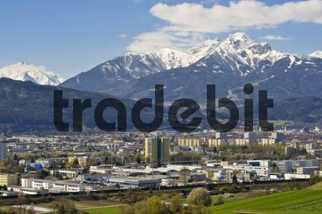 View of Innsbruck and snow-capped Mt. Serles, Mt. Nockspitze, Mt. Habicht and the Mutteralm ski area, Tyrol, Austria