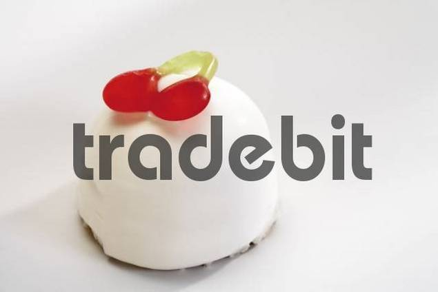 Marshmallow treat topped with cherry jujube, winegum