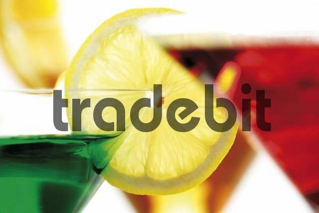 Colourful drinks in cocktail glasses