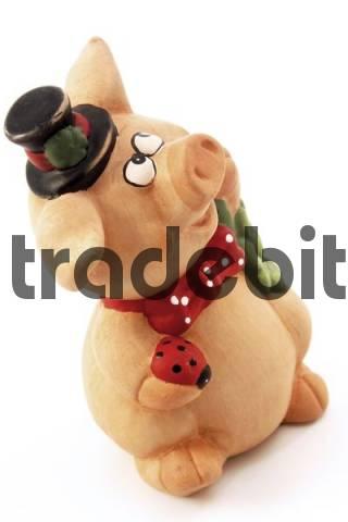 Piggy bank wearing a top hat