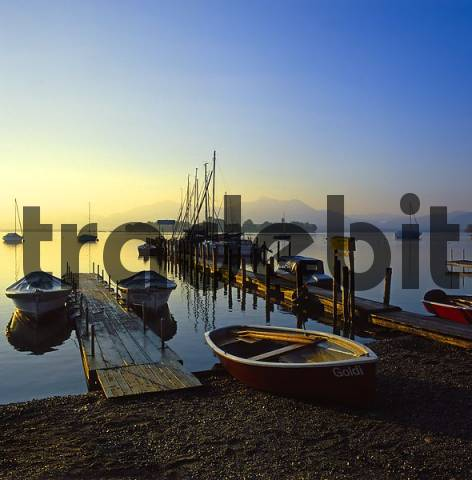 Fraueninsel in Chiemsee Upper Bavaria Germany seen from Gstad in front of the mountain Hochgern and Hochfelln mountains of Chiemgau