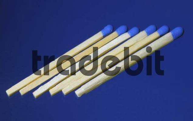 Matches on blue surface