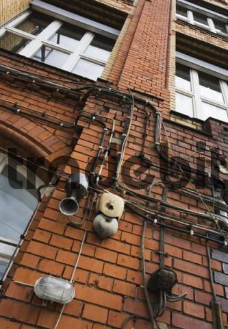 Acoustic siren and old doorbell at the facade of an old factory building in Berlin, Germany, Europe