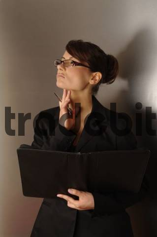 Free Businesswoman, aged 24, holding a notebook Download thumbnail
