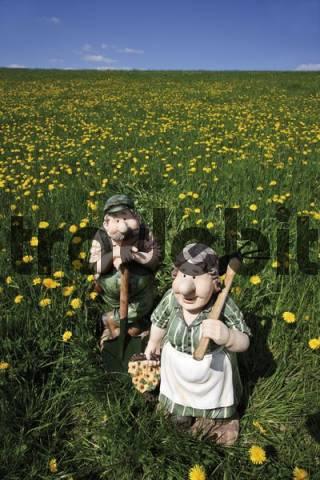 Figurines, husband and wife gardeners or farmers