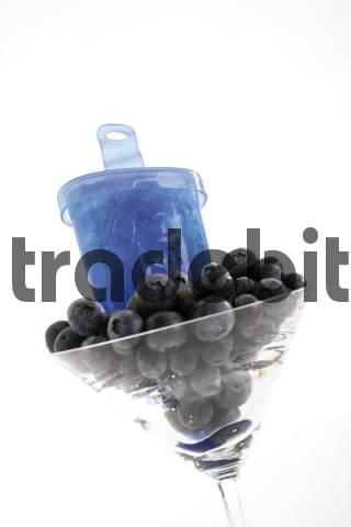 Homemade popsicle, ice lolly or ice pop mould, blueberries in a glass