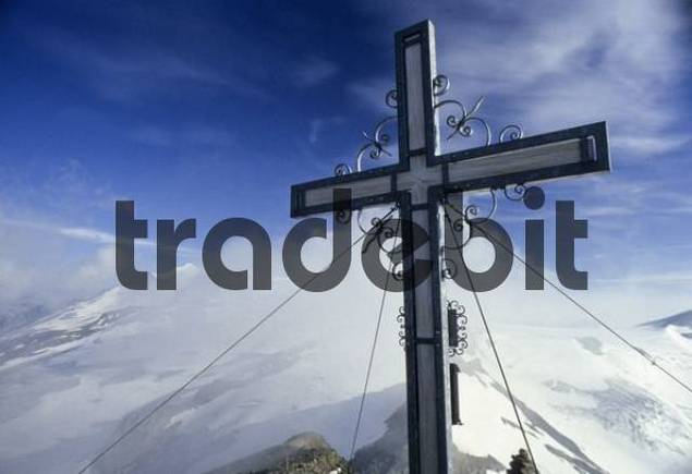 Mt. Weissspitze, forged summit cross, Venice Group in clouds in the back, Hohe Tauern Range, Tyrol, Austria, Europe