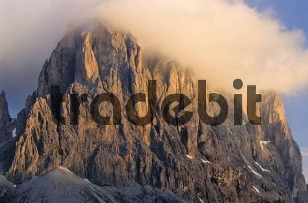 Rock face of Mt. Langkofel, wispy clouds in pale evening light, Dolomites, Bolzano-Bozen, Italy, Europe