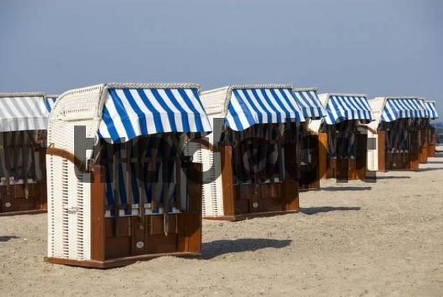 Empty roofed wicker beach chairs, off season, Travemuende Beach, Schleswig-Holstein, Germany, Europe