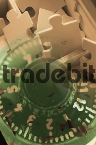 Composite of puzzle pieces and combination lock