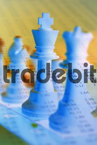 Composite of chess figures and stock page