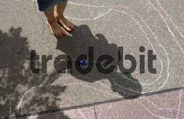 shadow of a playing child with blue toy car