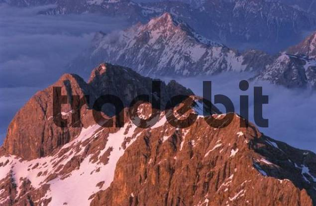 View from the summit of Mount Zugspitze, mountain peaks bathed in pink evening light, Bavaria, Germany, Europe