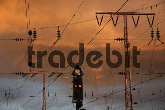power supply lines in front of a sky with sunset