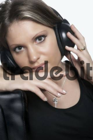 Young woman with headphones listening to her favourite music