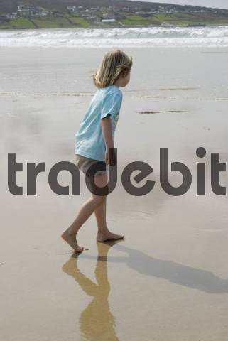 Blonde girl, 5 years old, running barefoot over the damp sand, Donegal, Ireland, Europe