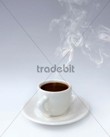 Cup of steaming hot black coffee on a saucer