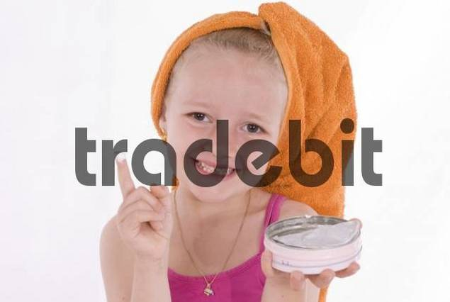 Girl, 6 years old, with face cream