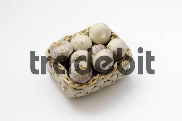 Cloves of garlic in a basket