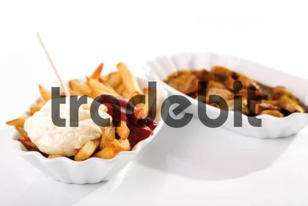 Curry sausage, chips and mayonnaise