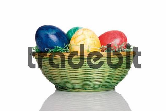 Easter basket with coloured Easter eggs