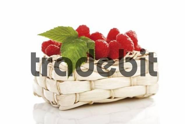 Raspberries in a bast basket