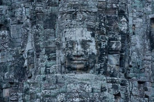 Stone sculptures, faces on the Bayon Temple in Angkor Thom, Siem Reap, Cambodia, Southeast Asia