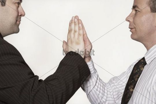 Two businessmen doing a high five