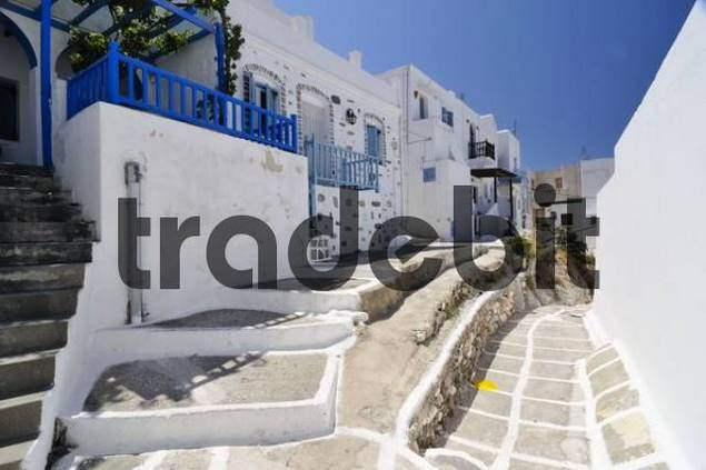 Alley with painted paving stones in Naoussa, Paros, Cyclades, Greece, Europe