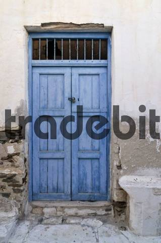 Wooden door with weathered blue paint in Naxos, Cyclades, Greece, Europe