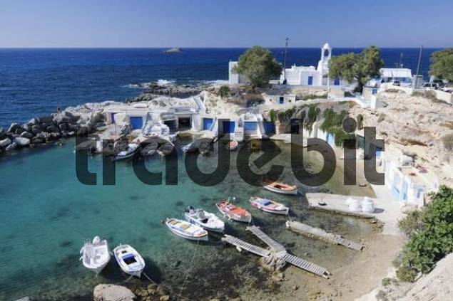 Small fishing village with boats and a port on Milos Island, Cyclades, Greece, Europe