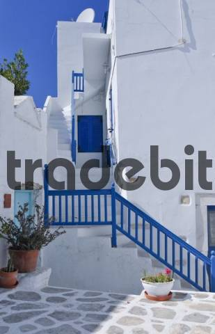 House with a staircase with a blue wooden balustrade in Naoussa, Paros, Cyclades, Greece, Europe