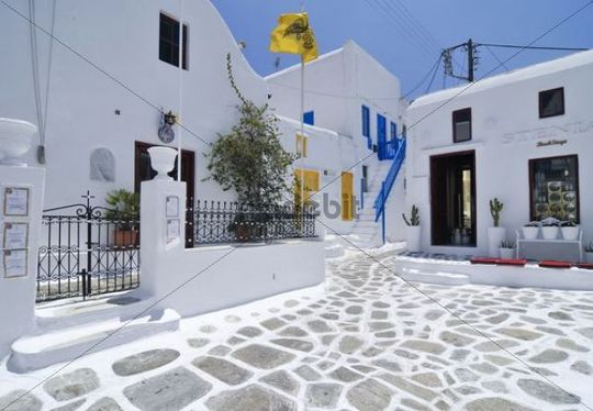 Stone paved square with white houses in Mykonos, Cyclades, Greece, Europe