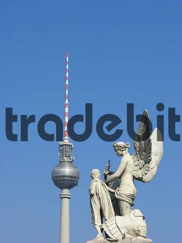 TV tower and angel figure in front of the Berlin sky
