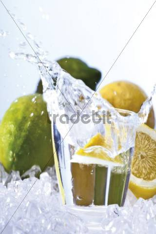 Lemon falling in a glass of water