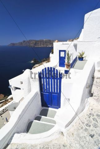 Entrance to the inner courtyard of a house with a blue door in Oia, Ia, Santorini, Cyclades, Greece, Europe